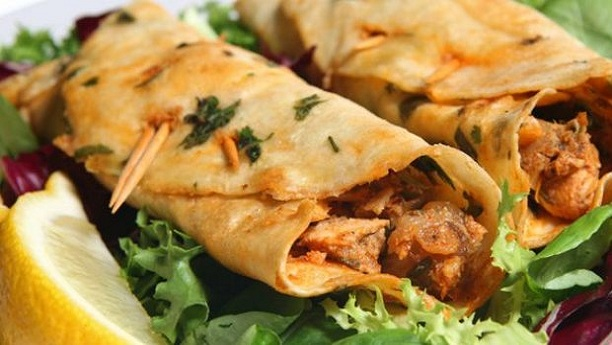 chicken tikka roll serve it with cucumber yoghart.